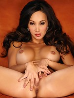 Katsuni gently touches the length of her body before fingering herself.