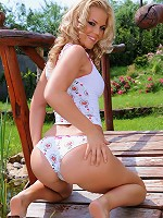Sexy babe Tricia is fingering on the lap of nature