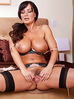 Lisa Ann strips out of her sexy lingerie and caresses her big breasts.